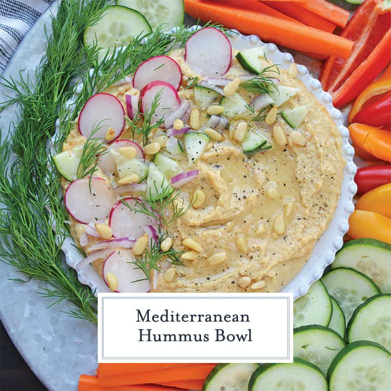 Overhead of hummus bowl with colorful veggies