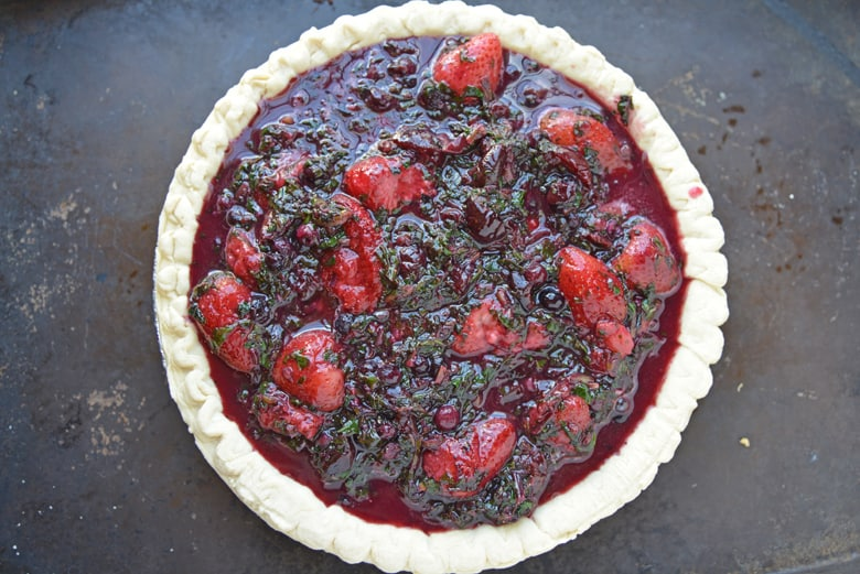 uncooked mixed berry pie in crust