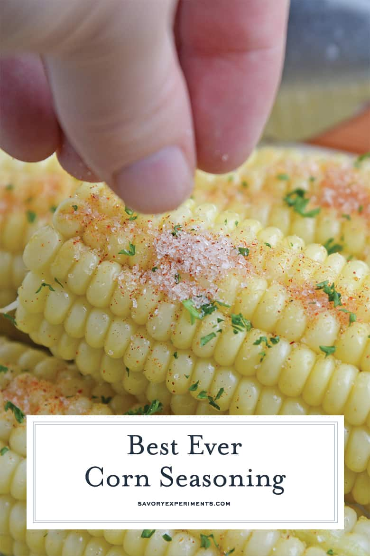 sprinkling corn seasoning on an ear of corn