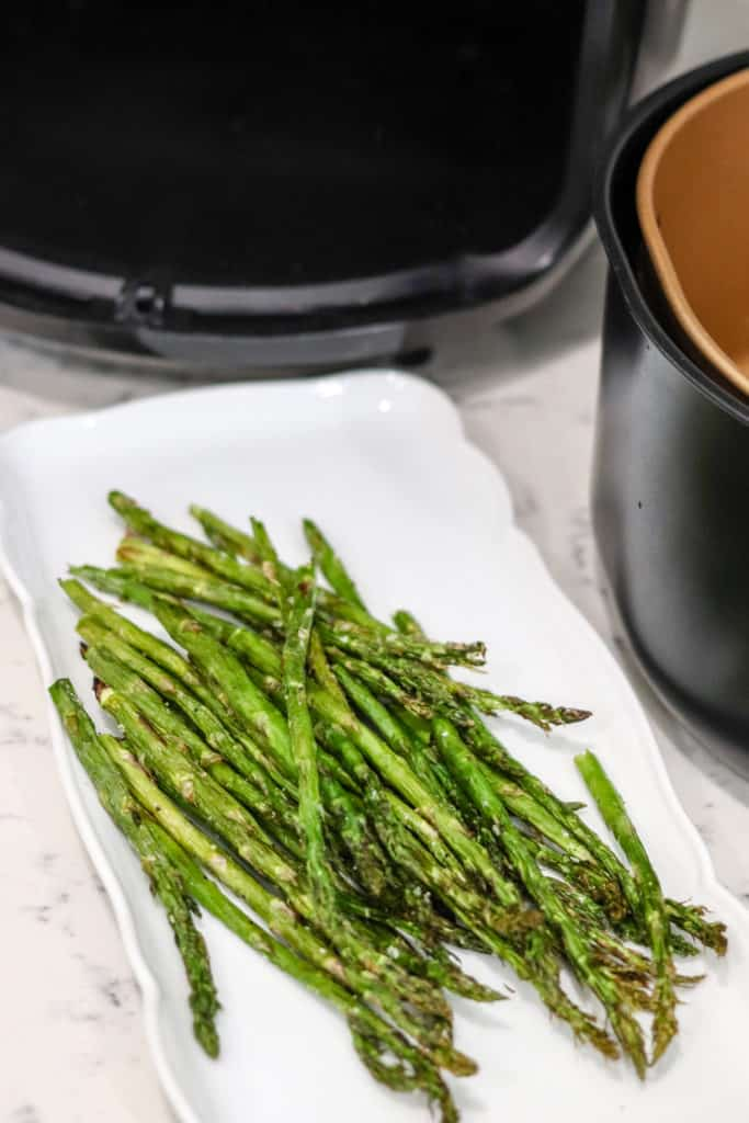 Air fryer asparagus on a white plate
