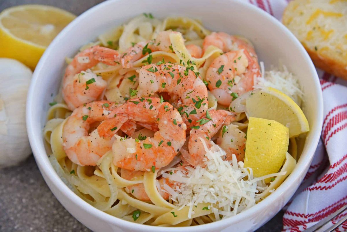 Shrimp scampi in a white serving bowl