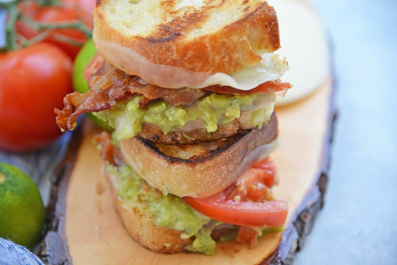Angle view of a stacked guacamole grilled cheese sandwich