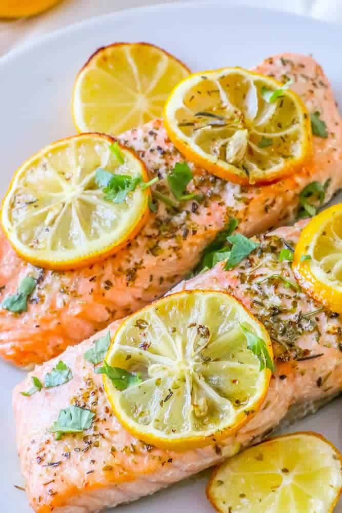 Close up of air fryer salmon topped with lemon slices
