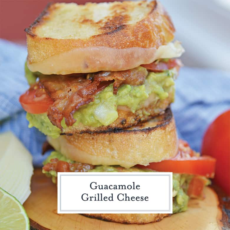Guacamole grilled cheese sandwich layered with cheese, tomato and bacon