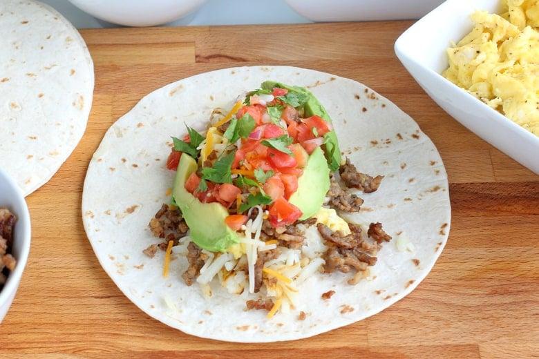 Open face breakfast burrito with avocado, cilantro