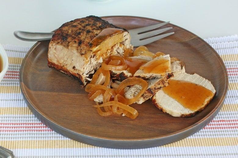 Pork loin roast on a wooden dish