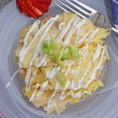 spoonful of breakfast casserole with sour cream drizzle