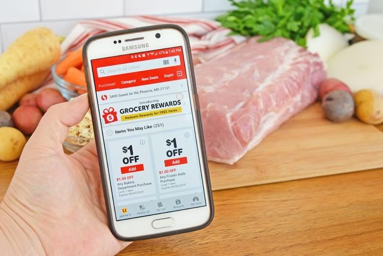 Safeway coupon app in hand