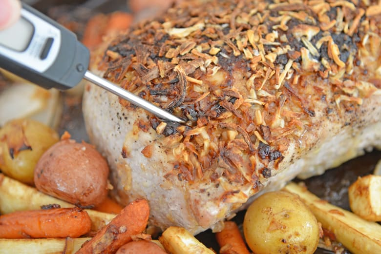 Instant Read Thermometer reading temperature for pork loin