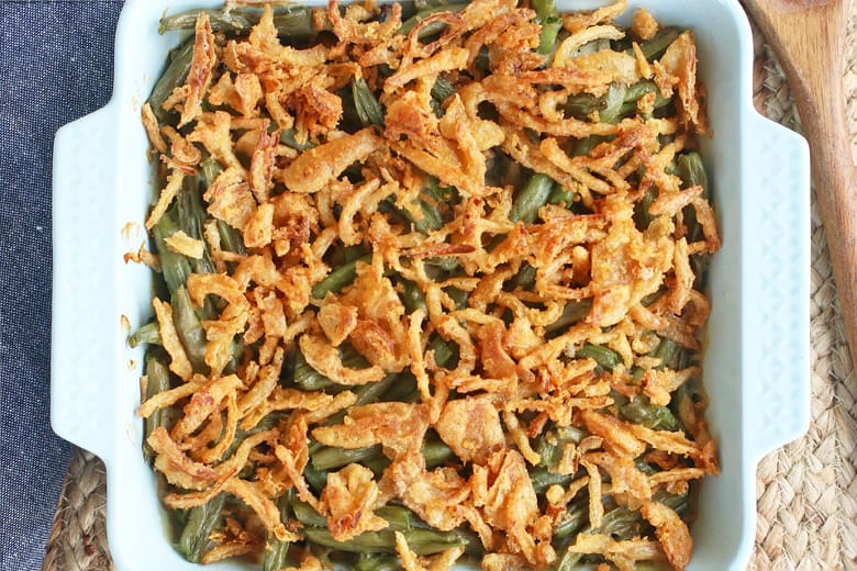 A close up of green bean casserole with crunchy onion topping
