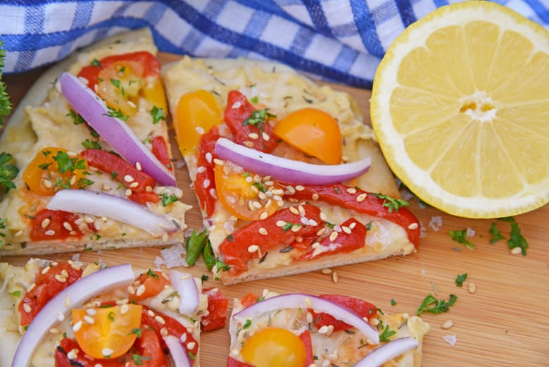 Angle shot of vegetable flatbread cut into pieces