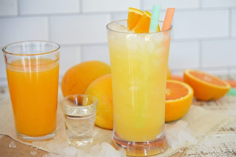 Orange crush cocktail with fresh oranges.