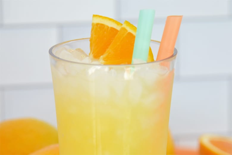 Orange crush cocktail in a glass with orange slices as a garnish