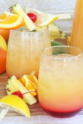 glasses of rum punch with fruit garnishes