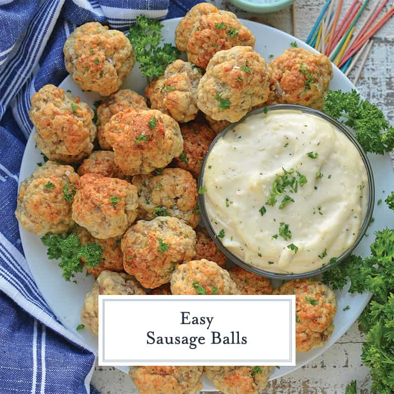 Easy Sausage Balls on a white serving dish with garlic aioli dipping sauce