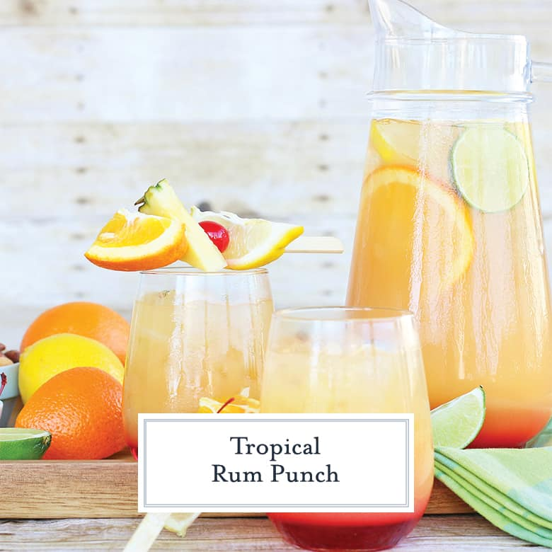 Pitcher and two glasses of rum punch with fresh fruit