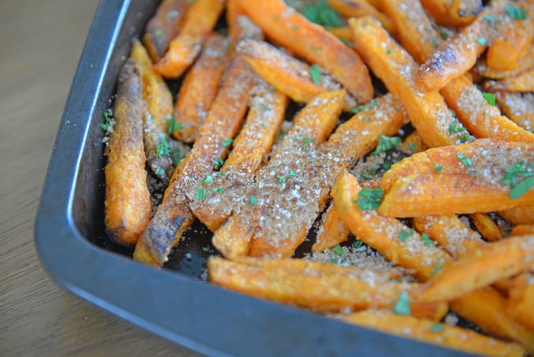 Brown sugar caramelized on sweet potato fries on a baking sheet
