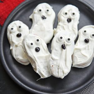 ghost Cookies on a black plate
