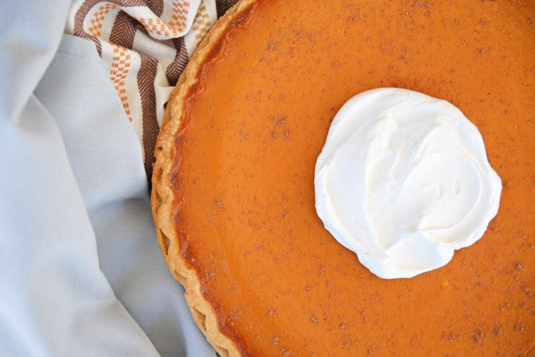 Delicious pumpkin pie on jewel toned linens
