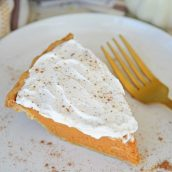 slice of frosted pumpkin pie