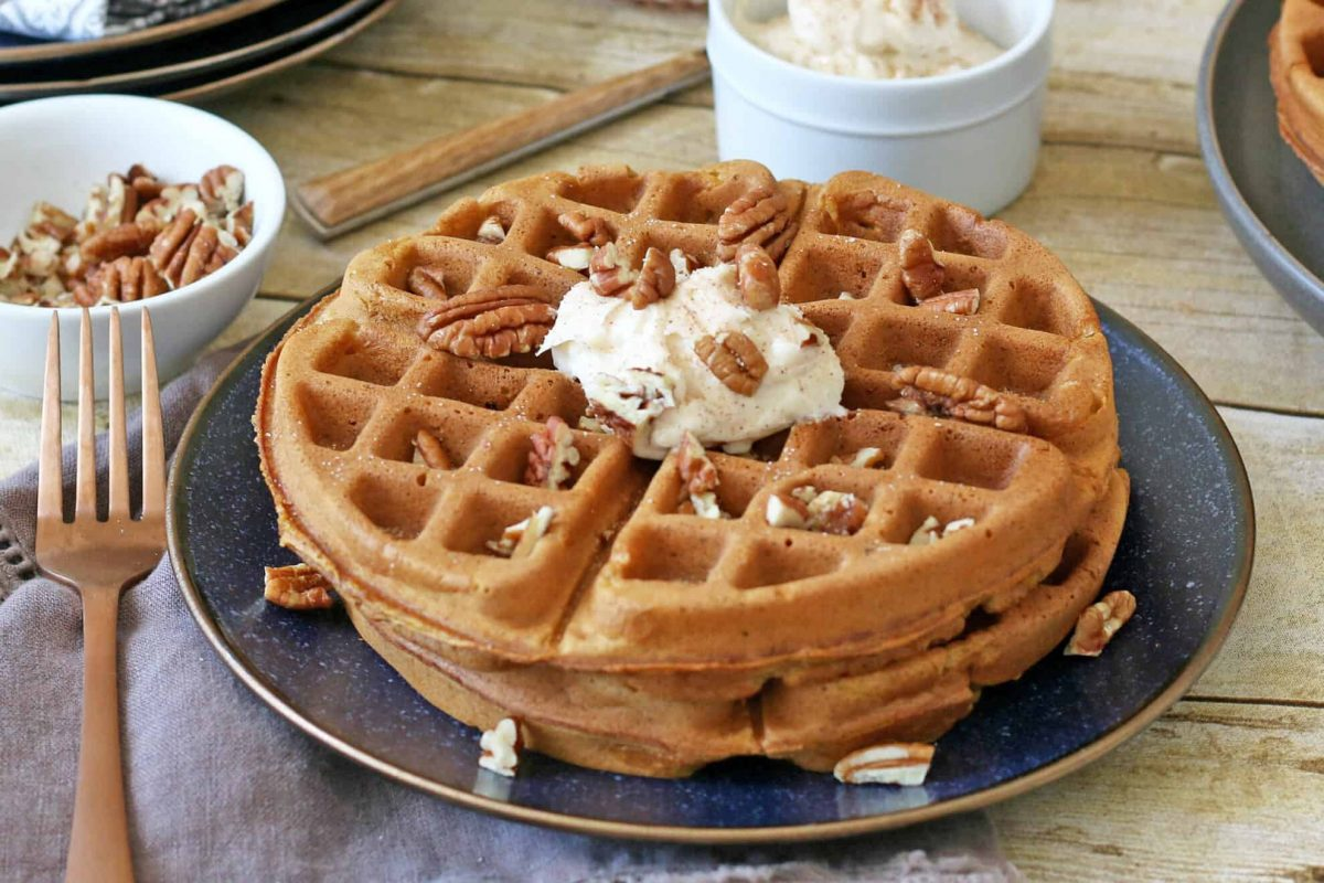 Close up of pumpkin waffles on a blue plate