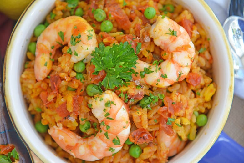 Close up of a bowl of shrimp paella