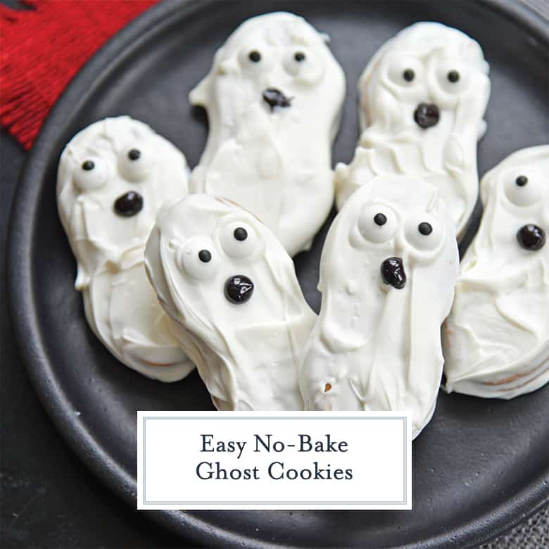 Black plate with white ghost cookies