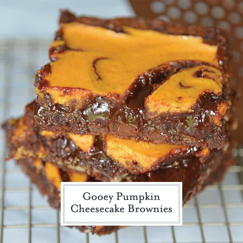 Stacked pumpkin cheesecake brownies with a gooey center