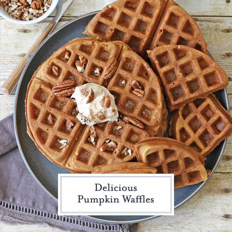 Overhead of pumpkin waffles with honey cinnamon butter and walnuts