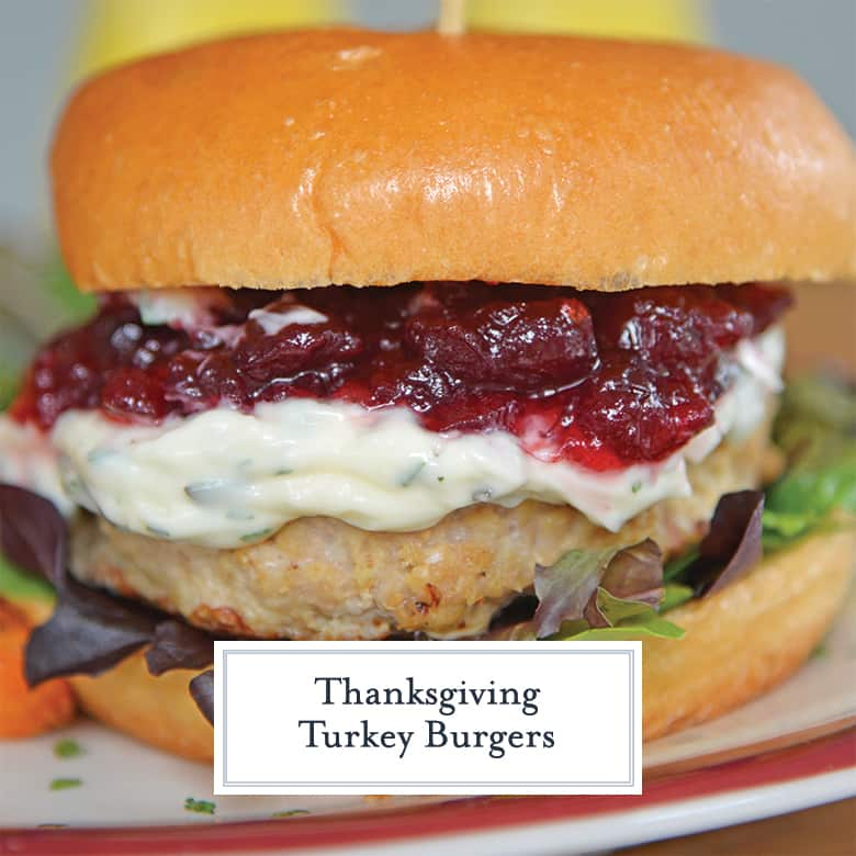 Turkey burger on a brioche roll with herbed mayo and cranberry sauce