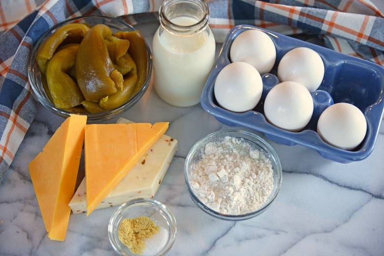 Ingredients for chile relleno casserole on a marble cutting board