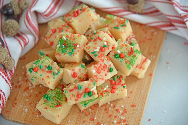 Pile of Christmas fudge on a wood cutting board