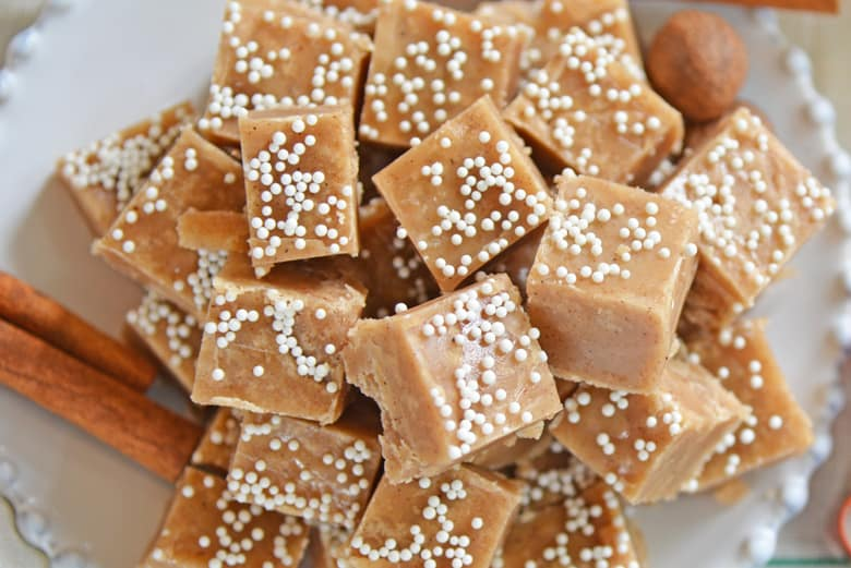 Lots of gingerbread fudge squares on a white dish