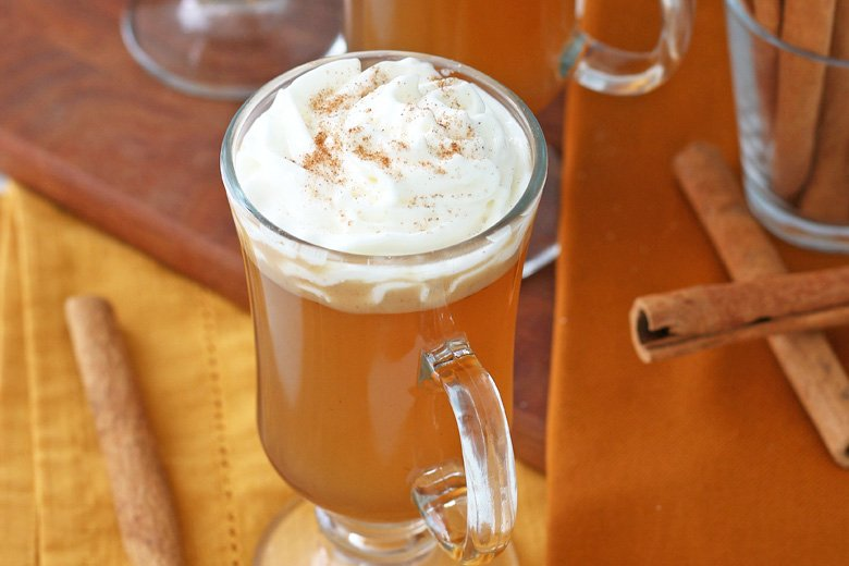 Top of hot buttered rum with whipped cream and cinnamon sprinkle