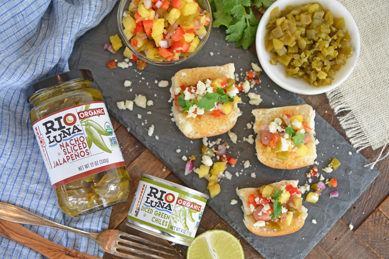 Pineapple salsa on hot dog sliders with Rio Luna Peppers