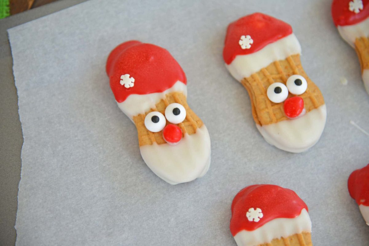 Finished Santa Cookies on parchment paper