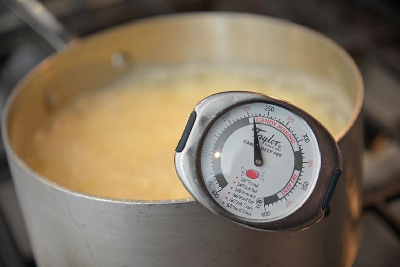 Candy thermometer on a saucepan of fudge