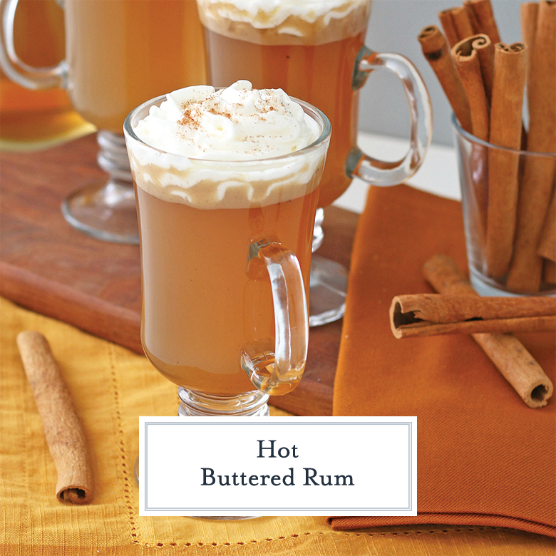 Hot Buttered Rum in a clear glass mug with whipped cream