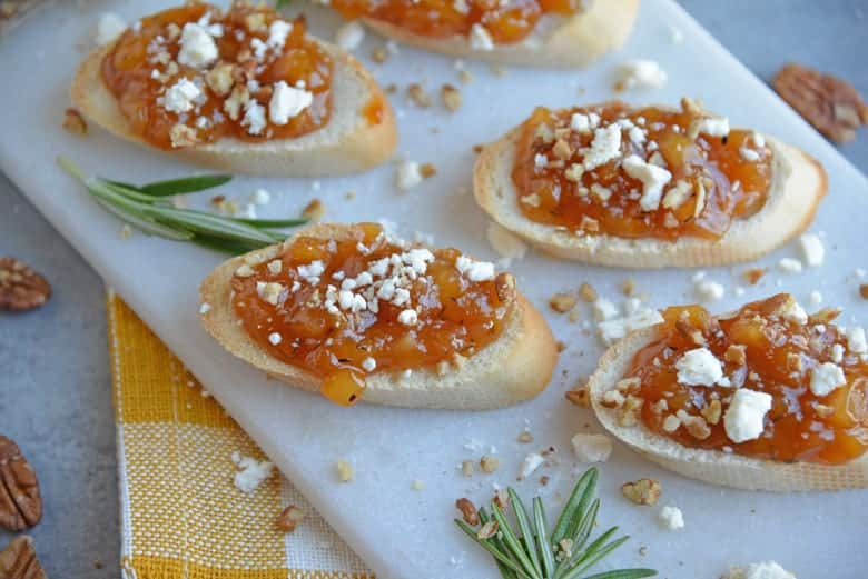 pear and apricot crostini on a serving platter