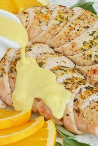 close up of roast turkey breast with orange gravy