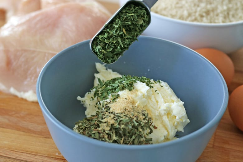 Dried herbs in butter in a bowl mixing bowl