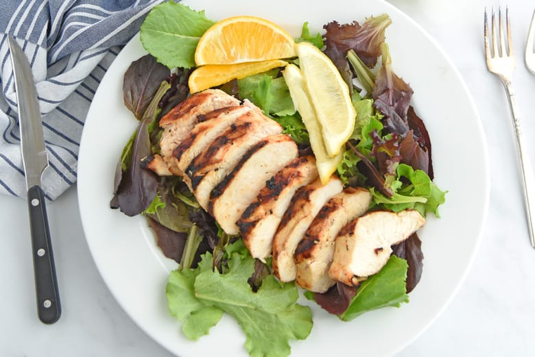Grilled sliced chicken on a salad