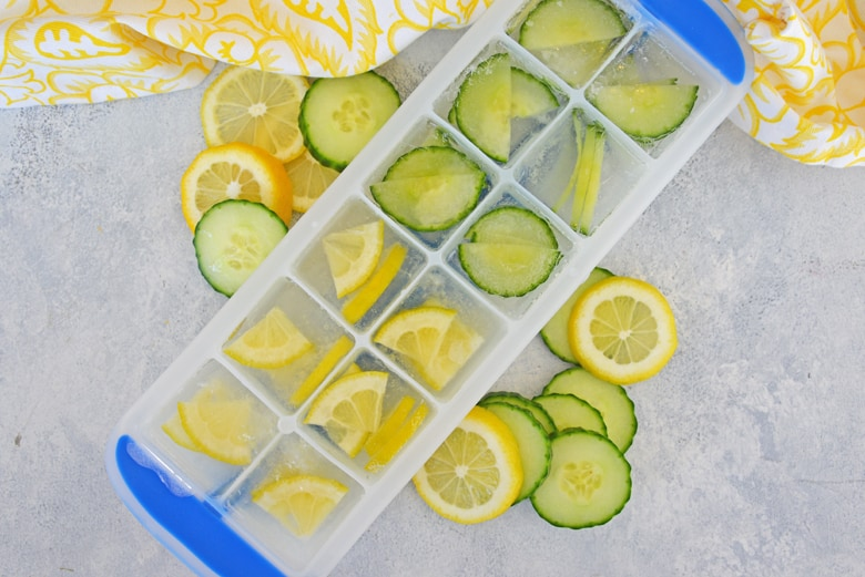 Lemons and cucumber in an ice cream tray