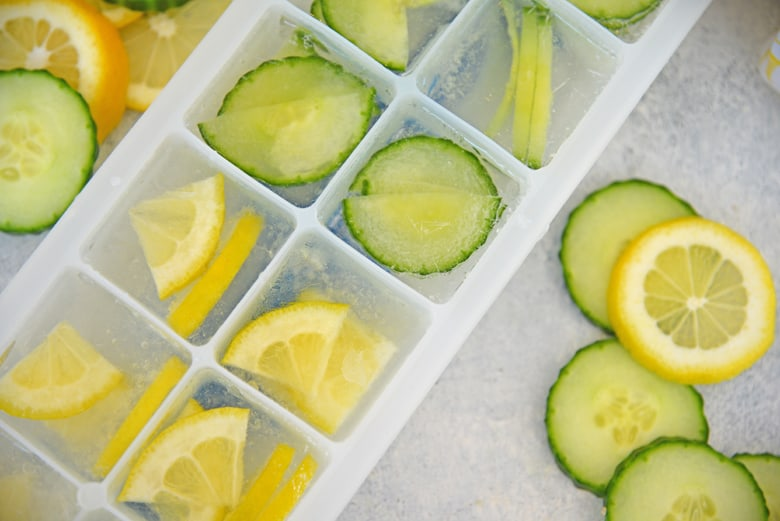 Close up of lemons and cucumbers in an ice cube tray