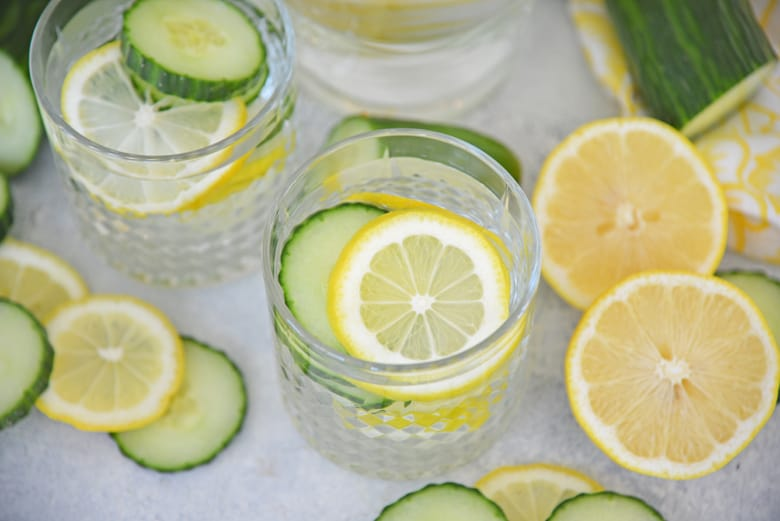 Overhead shot of lemons and cucumbers in a glass