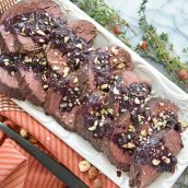 serving platter of beef tenderloin with blueberry sauce