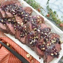 serving platter of beef tenderloin with blueberry sauce