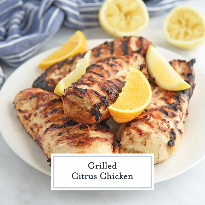 Grilled Chicken with Lemons on a White Plate