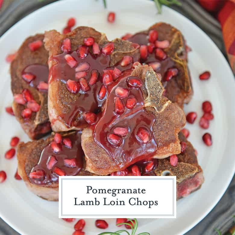 Lamb loin chops on a white plate with pomegranate sauce.