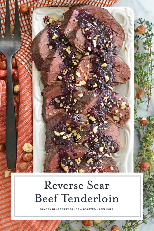 Overhead of beef tenderloin sliced on a serving platter